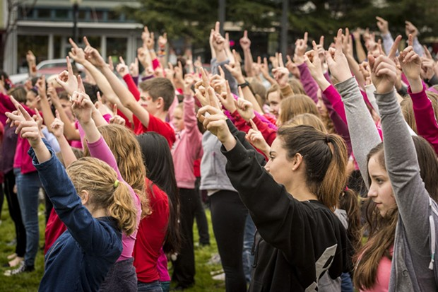 Hands go up on the Arcata Plaza at One Billion Rising. - MARK LARSON