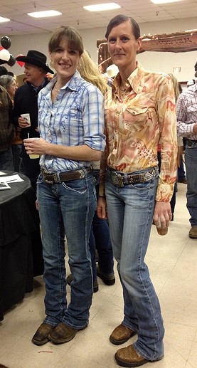 Brandy Mincks and Sorrel Divis button up and buckle up. - JENNIFER FUMIKO CAHILL