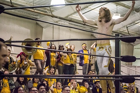 Brett Walters (aka Rocket Boy Brett) paused during his tag-team match to soak in support from his fellow HSU students and friends and The Marching Lumberjacks band. - MARK LARSON