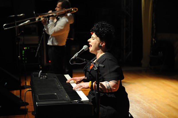 Davina Sowers, frontwoman for Davina in the Vagabonds, plays the keyboards during the dance party at the municipal auditorium on Saturday night. - MARK MCKENNA