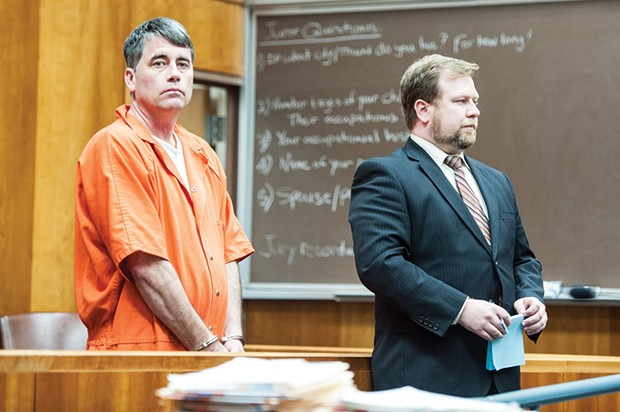 Gary Lee Bullock stands next to his attorney, Kaleb Cockrum, at his arraignment in January of 2014. - PHOTO BY MARK MCKENNA