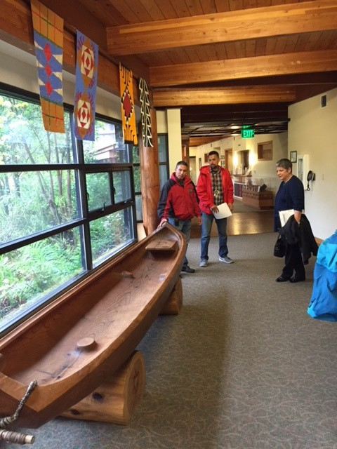 Alme Allen talks about a canoe built for the health village. - GRANT SCOTT-GOFORTH