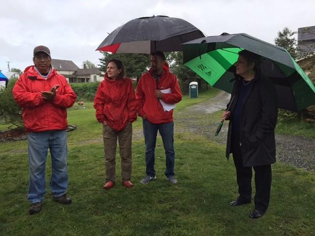 Garden manager Ed Mata, left, talks with Napolitano, right. - GRANT SCOTT-GOFORTH