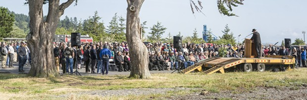 Pastor Rick McRostie, of Eureka, began the memorial for Jimmy Smith held Friday, May 27 at the Jimmy Smith Fields Landing Boat Launch in Fields Landing. - MARK LARSON