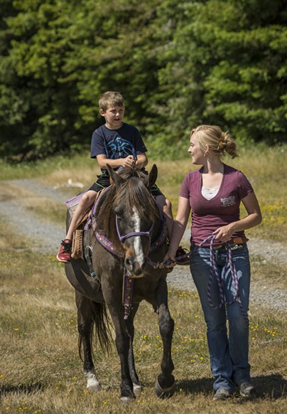 Landon Porter, 7, Crescent City, enjoyed the horseback rides offered by Hailey Ford, McKinleyville and the Redwood Creek Buckarettes. The group offers guided tours in Redwood National Park. - MARK LARSON