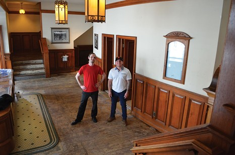 McKinlay and Neff in the Minor lobby during renovations. - FILE