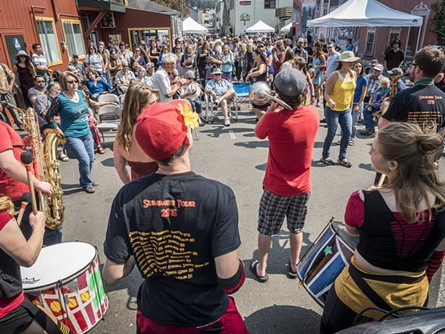 A large crowd filled the space between Los Bagels and Wildwood Music to listen to SambAmore at the I Block party on Monday. - MARK LARSON