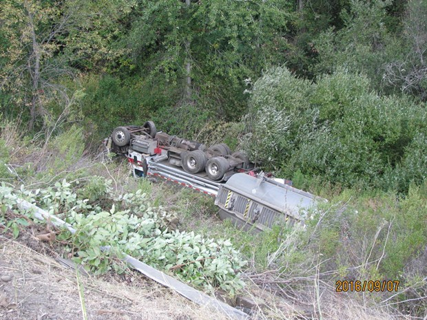 Caltrans reported the overturned truck's tanks were intact with minimal leaking observed on Thursday. - FACEBOOK