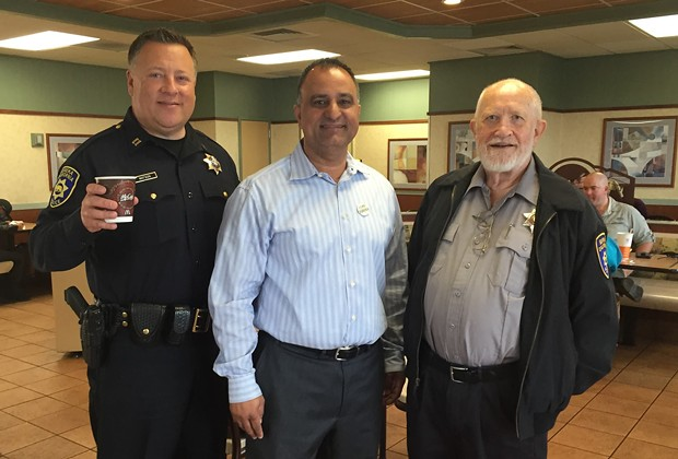 Longtime taxpayer advocate Leo Sears, far right, pictured at a Coffee with a Captain event, has died. - FACEBOOK