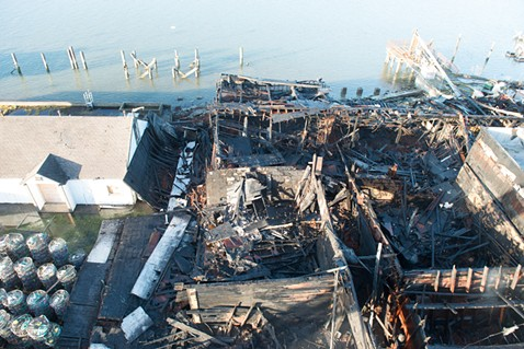 An overhead view of the remains of the commercial building. - MARK MCKENNA