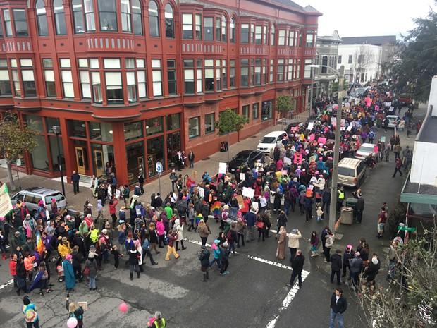 Marchers turn onto Third Street. - MARK MCKENNA