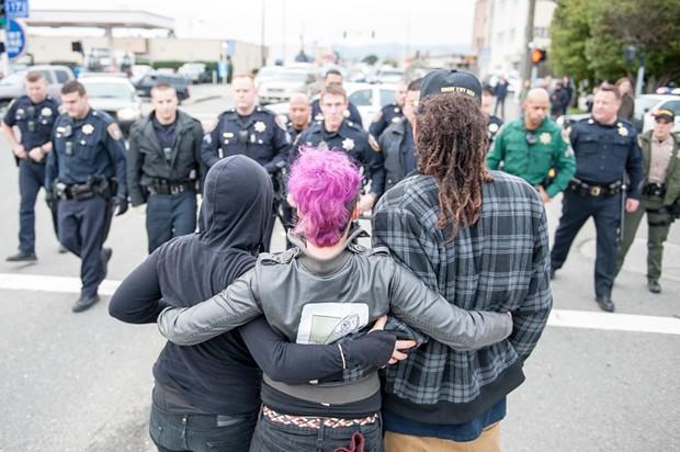 Protesters stand their ground. - MARK MCKENNA