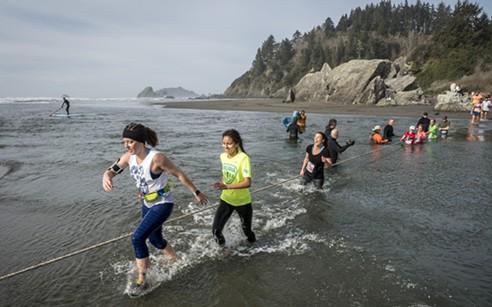 Splashing across Little River toward the finish line. - PHOTO BY MARK LARSON