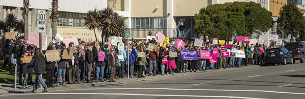 A crowd of more than 200 pro-choice and pro-Planned Parenthood supporters carry signs, chant and wave to passing drivers on Fifth Street outside the Humboldt County Courthouse on Saturday afternoon. - MARK LARSON