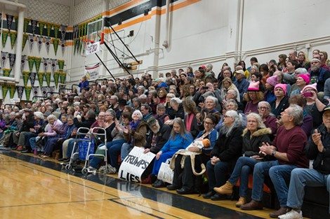 People flocked to Arcata High School, many with signs in hand, Thursday for a town hall meeting with North Coast Congressman Jared Huffman. - BEAU SAUNDERS