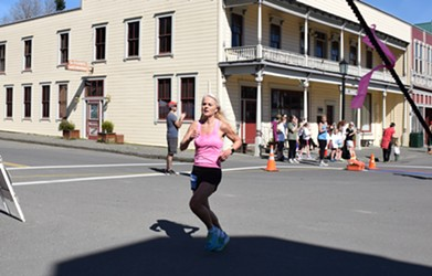 Lanore Bergenske was the first woman of the day to cross the finish line in the 4-mile. - JENNIFER FUMIKO CAHILL