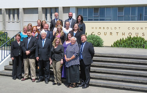 Public Defender staff gathered with now retired Public Defender Kevin Robinson (center).