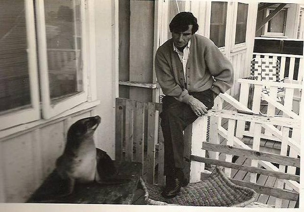 Glenn Miller sitting with Suzie the seal he rescued and nursed back to full health. - SUBMITTED