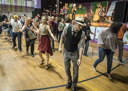 Line dancers filled the floor at the Grand Finale at the Muni on Sunday afternoon. - PHOTO BY MARK LARSON