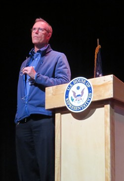Huffman listens to a question at last night's town hall. - TONY REED