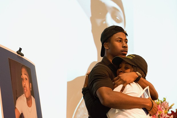 Lawson's mother is comforted by one of his friends. - MARK MCKENNA
