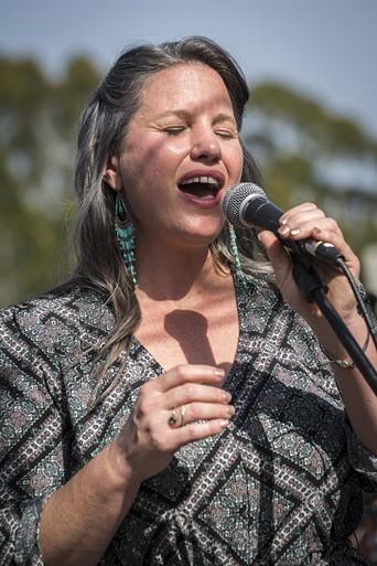 Megan Hendley rang them bells at the Dylan to-do. - PHOTO BY MARK LARSON