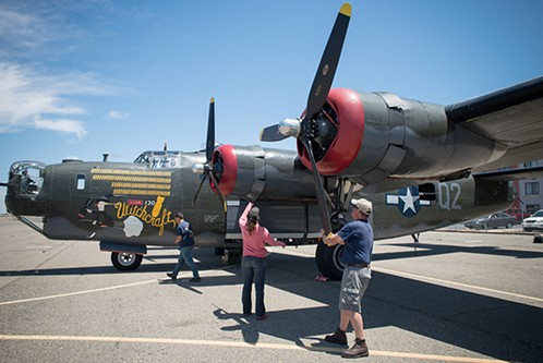 The crew of the Witchcraft, a B-24 Liberator, prepares for takeoff. - PHOTO BY MARK MCKENNA