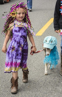 River Christie, of Blue Lake, and her costumed pet goat. - MARK LARSON