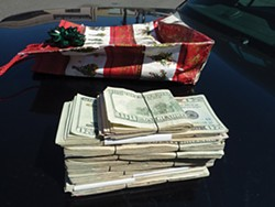 Marijuana and more than $11,000 in cash found during a traffic stop were seized for asset forfeiture proceedings. - PHOTO COURTESY OF EUREKA POLICE DEPARTMENT.