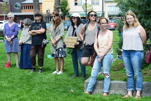 Around 60 people gathered at the Arcata Plaza's Southeast corner on Sunday for a vigil to stand in solidarity with Charlottesville, Virginia, following a deadly car attack on protesters Saturday. - MARK MCKENNA