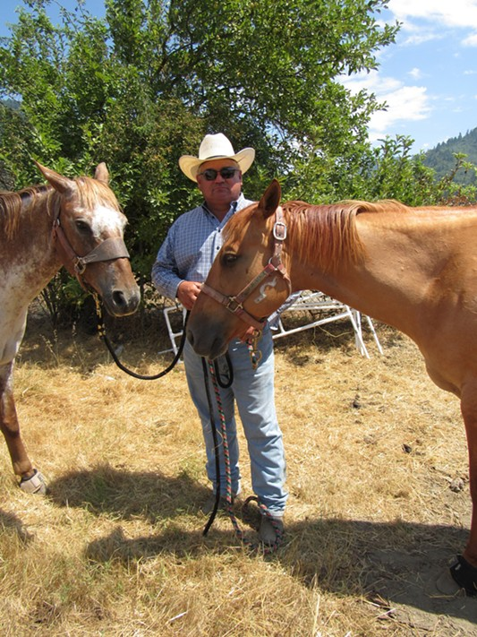 Jerry Parrish with Barker and Kitty. - LINDA STANSBERRY