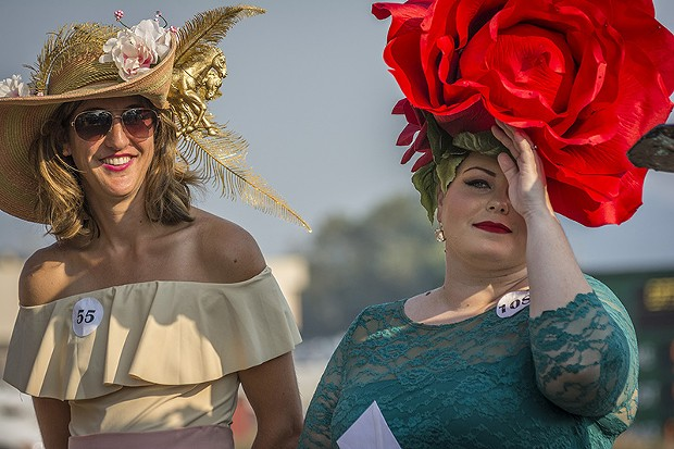 Heather Bellinger and Paulette Hanson looking blooming lovely on Ladies Hat Day. - PHOTO BY MARK LARSON