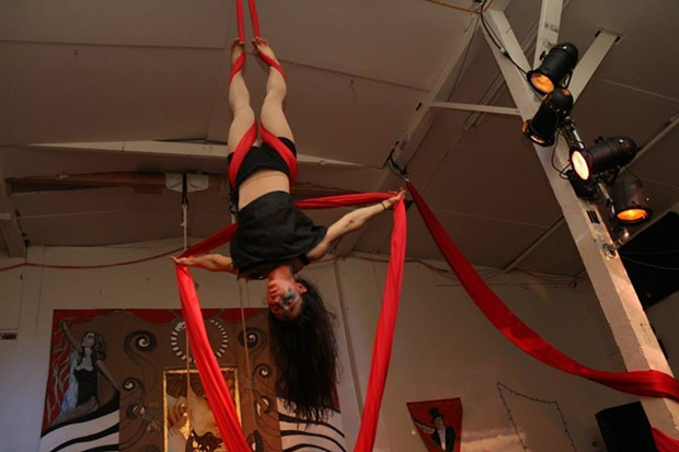 An aerialist performing at the soon-to-be-vacated Synapsis Studio. - COURTESY OF LESLIE CASTELLANO