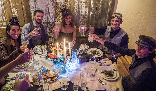 A table of guests at the Fall Splendor event toasts in their steampunk finery. - PHOTO BY MARK LARSON