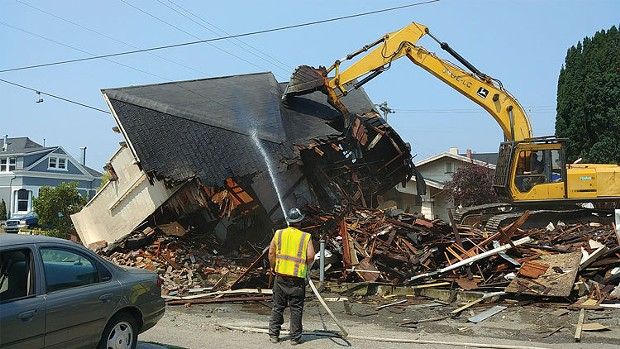 The city tears down a house owned by the Squireses on H Street. - COURTESY OF CITY OF EUREKA