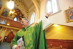 Father Eric Freed during the 125th anniversary Mass at St. Bernard's Church in 2011. - PHOTO BY MARK MCKENNA