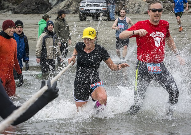 Crystal Mendez (left) and  Chris Schinke raised a splash at the Little River crossing in the 8 3/4-mile race. - PHOTO BY MARK LARSON