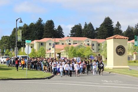 """Protesters march from Humboldt State University to Arcata City Hall, demanding """"justice for Josiah"""" Lawson. - THADEUS GREENSON"""