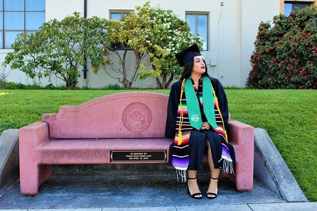 Rosibeth Cuevas, 21, sits on a bench that was dedicated to those who died in a 2014 bus crash in Orland. A survivor of the crash, Cuevas is now graduating from Humboldt State University. - COURTESY OF SOFIA TAM