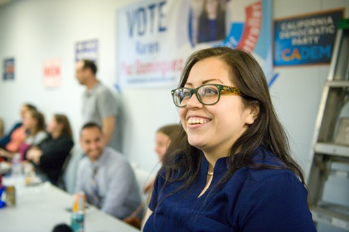 Karen Paz Dominguez flashes a smile as she watches the results come in. - MARK MCKENNA