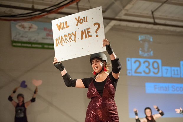 Natalie Arroyo proposes to Jason Lopiccolos at the final derby bout of the season. - PHOTO BY MARK MCKENNA