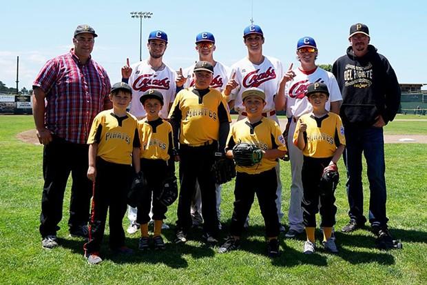 Crabs players pose with Crescent City Pirates on Little League Sunday - MATT FILAR