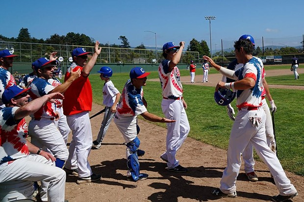 Crabs celebrate a run during Saturday's game. - MATT FILAR