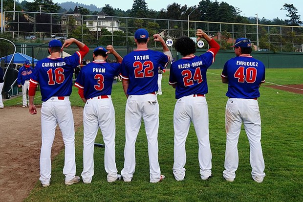 Crabs players show off their Blue uniforms. Home-run champ of the series, #40 Ramon Enriquez far right. - MATT FILAR