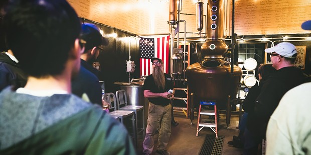Steve Bohner gives visitors a tour of the distillery.
