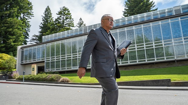 New Humboldt State University President Tom Jackson Jr. strolls across campus on June 28, his first day on the job.