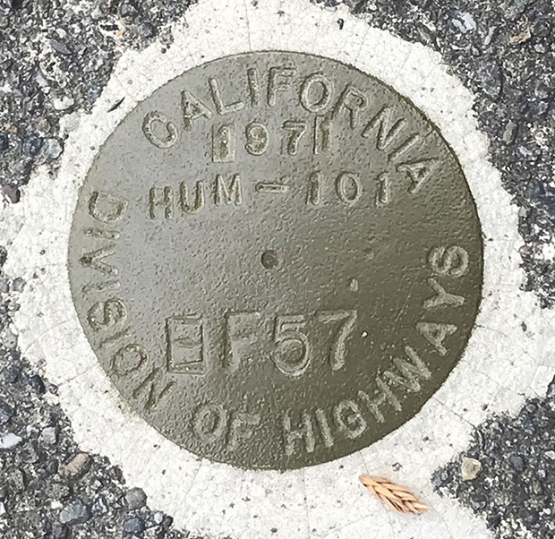 Cold forged silicon bronze survey marker at Ninth and I streets in Eureka. This would have been the centerline of U.S. Highway 101, had the Caltrans proposed relocation of 50 years ago gone ahead.