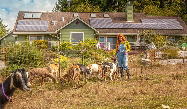 Karin Eide at the farm, in front of the solar-powered cheese-making facility.