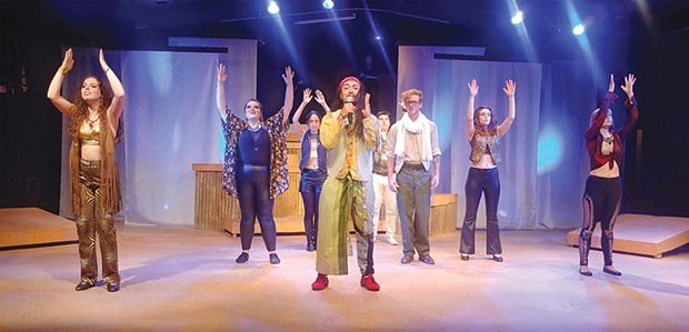 Center: Tiggerbouncer Custodio and Jordan Dobbins get religion in the rock opera.