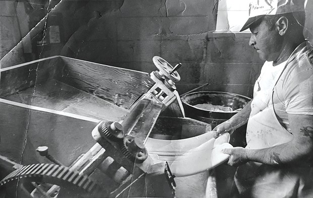 Gino Marcelli making ravioli with the same dough breaker machine the family business uses today.